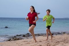 Two kids running together at morning exersises stock images