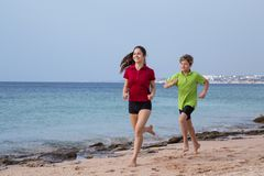 Two kids running together at morning exersises royalty free stock photo