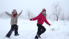 Two kids running together on winter landscape, slow motion. Two active kids running together on winter snow landscape, slow motion 250 fps stock video