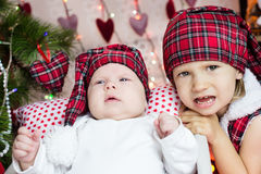 TWo kids in santa's hat Royalty Free Stock Photography