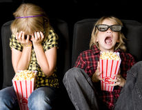 Two Kids at a Scary 3-D Movie Royalty Free Stock Image
