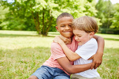Two kids scuffle in the park Royalty Free Stock Images