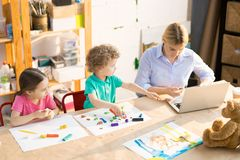 Children modeling clay in class royalty free stock photos