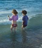 Two kids at sea. Two kids in the water at beach Stock Images