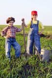 Two kids with shovel and can Royalty Free Stock Photography