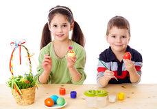 Two kids showing painted easter eggs Stock Photo