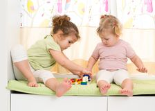Two kids sisters play together. At home Royalty Free Stock Photos