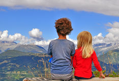 Two kids sitting on the top Royalty Free Stock Images