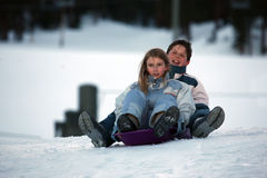 Two kids on sled Royalty Free Stock Images