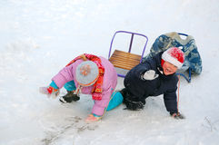 Two kids with sleds Stock Photography