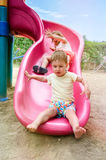 Two Kids on Slide Royalty Free Stock Photos