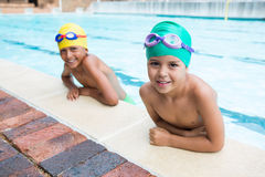 Two kids smiling in the pool Royalty Free Stock Image