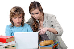 Two kids studying together. For a test Stock Photography