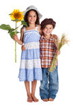 Two kids with sunflower and wheat Stock Image