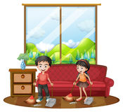 Two kids sweeping the floor Stock Photography