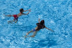 Two kids swim in pool together. Above view Stock Image