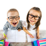Two kids at the table  in classroom on lesson Stock Photos