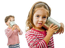 Two kids talking on a tin phone Stock Photos
