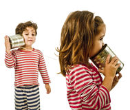 Two kids talking on a tin phone Stock Photo