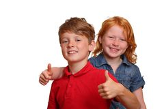 Two kids with thumbs-up Royalty Free Stock Photo