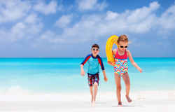 Two kids at tropical beach Stock Photos