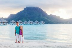 Two kids at tropical resort beach Stock Photography
