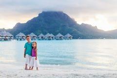 Two kids at tropical resort beach. On Bora Bora island stock photography