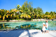 Two kids on a tropical vacation Stock Images
