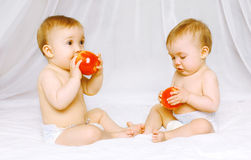 Two kids twins. On the bed Stock Photography