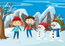 Two kids and two snowmen in the field Stock Images