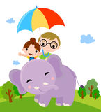 Two kids with umbrella and elephant Stock Photos