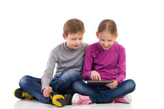 Two kids using digital tablet Royalty Free Stock Image