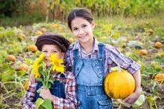 Two kids in vegetable garden Stock Images