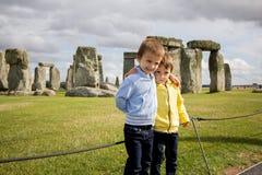 Two kids, visiting Stonehenge stock photography