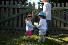 Two kids walk grandfather Royalty Free Stock Image