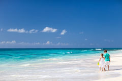 Two kids walking along a beach at Caribbean Stock Photo