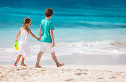 Two kids walking along a beach at Caribbean Stock Image