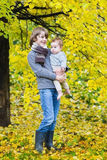 Two kids walking in an autumn park Royalty Free Stock Photography