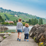 Two kids walking outdoors Royalty Free Stock Photos