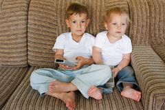 Two kids watching tv Stock Images