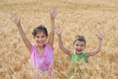 Two kids on a wheat field Stock Photo