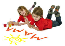 Two kids writing word Mama Stock Image