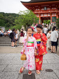 Two kimono's girl post at gate of kiyomizu-dera temple Royalty Free Stock Images