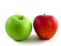 Two of a kind. Red and green apple on white background Stock Photos