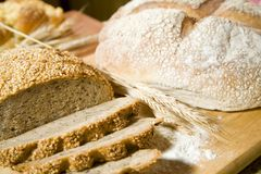 Two kind of bread and a wheat. Well smelled bread and a wheat Stock Photography