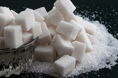 Two kind of sugar on black surface Royalty Free Stock Photo