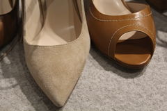 Two kind of women`s shoes Royalty Free Stock Image