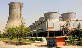 Two kinds of Cooling towers of Thermal Power Plant. Two kinds of Cooling towers (natural and forced/induced draft) of Thermal Power Plant at UP, India Stock Images