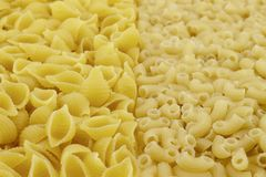 Two kinds of pasta.The foreground in focus, back is not present royalty free stock photos