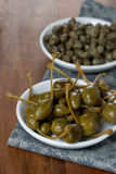 Two kinds of pickled capers Royalty Free Stock Image